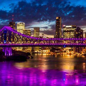 Vibrant night time panorama of Brisbane city with Story Bridge